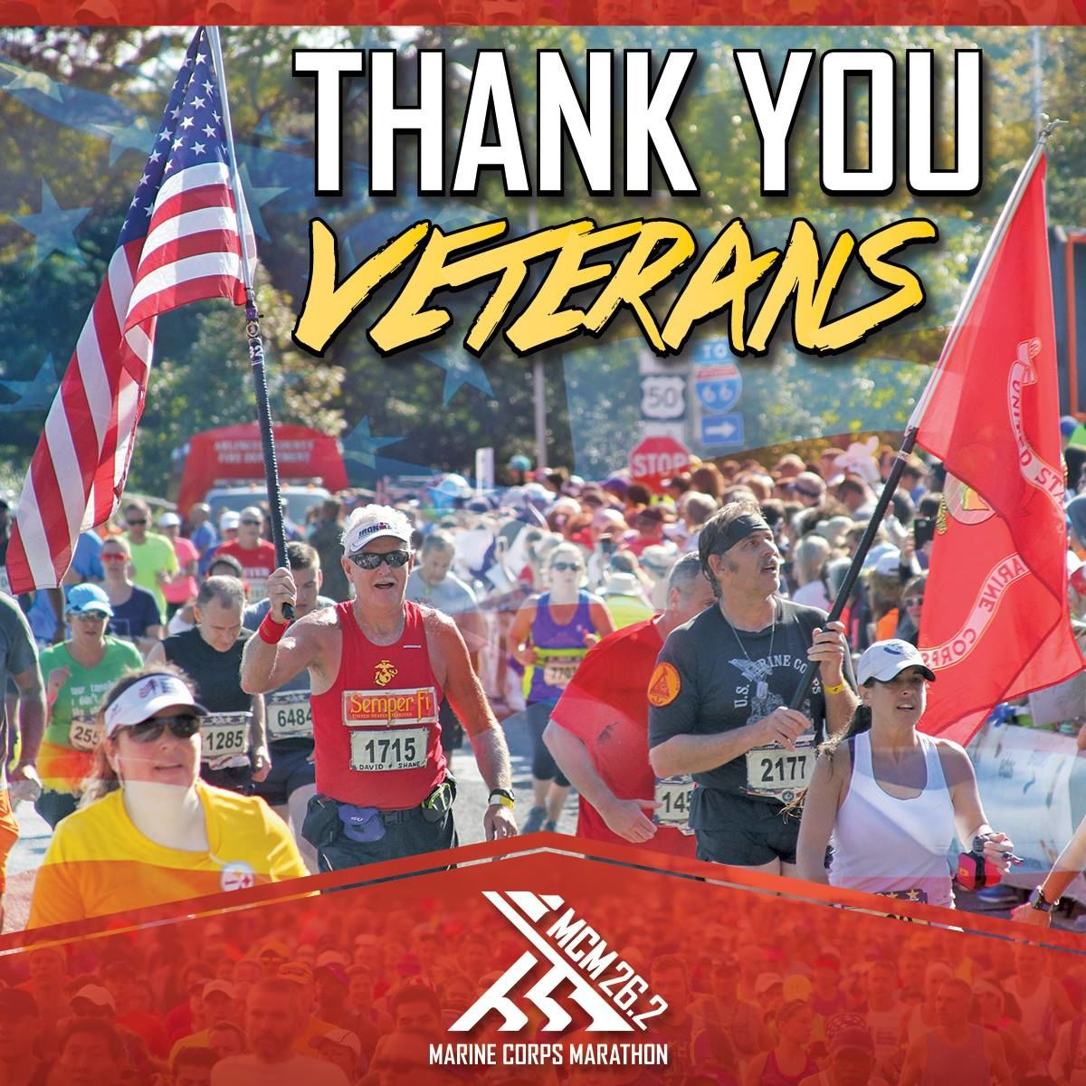 Steve Bozeman is pictured here holding the American flag while running the Marine Corps Marathon. (Courtesy Steve Bozeman)