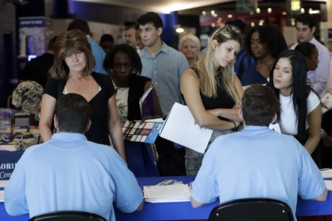 US companies hiring at robust pace, wages rise faster