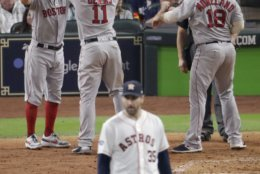 Boston Red Sox's Rafael Devers celebrates his three-run home run off Houston Astros starting pitcher Justin Verlander during the sixth inning in Game 5 of a baseball American League Championship Series on Thursday, Oct. 18, 2018, in Houston.(AP Photo/Lynne Sladky)