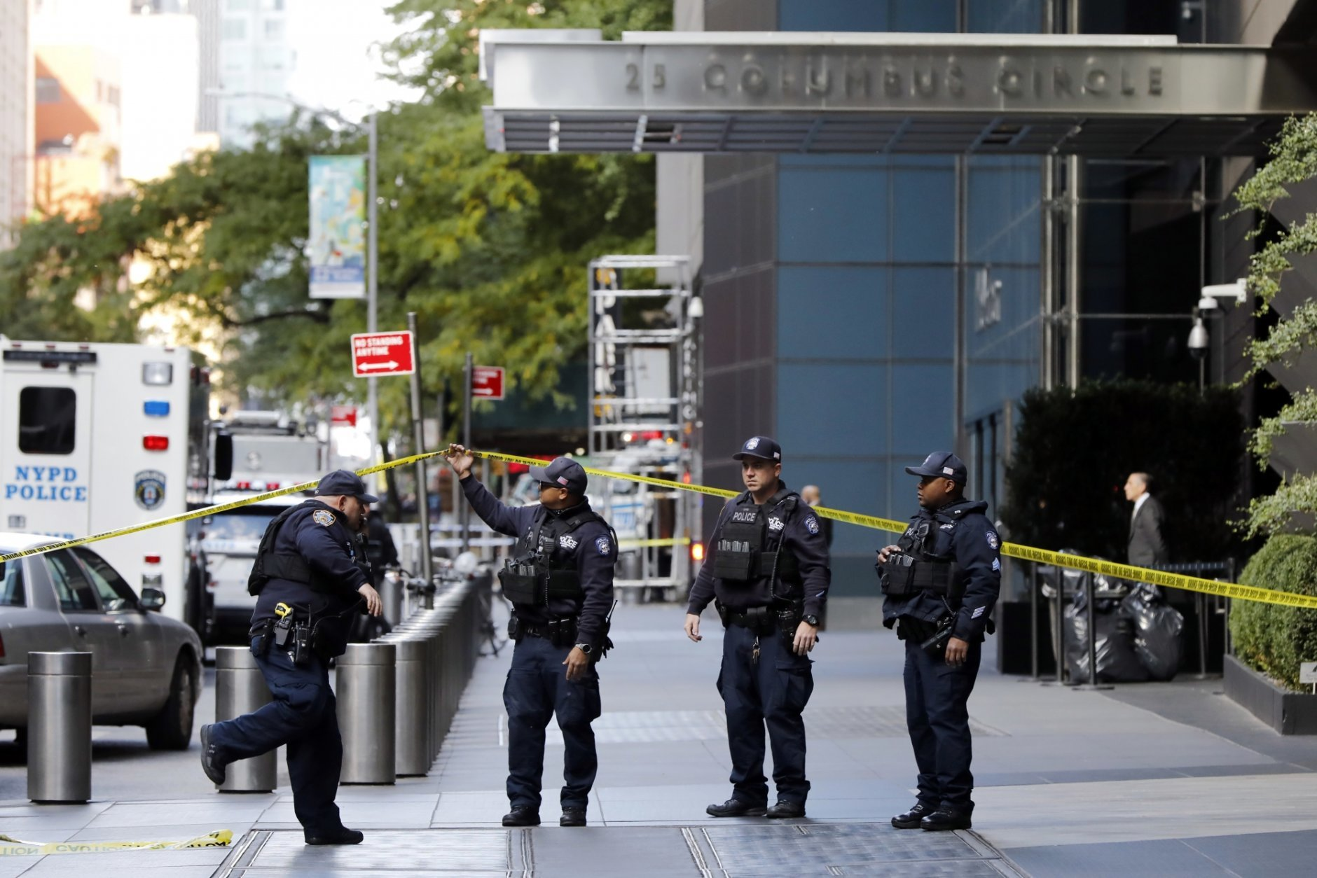New York City Police Dept. officers arrive outside the Time Warner Center, in New York, Wednesday, Oct. 24, 2018. A police bomb squad was sent to CNN's offices in New York City and the newsroom was evacuated because of a suspicious package. (AP Photo/Richard Drew)