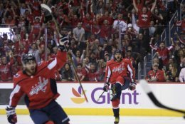 Washington Capitals left wing Alex Ovechkin (8), of Russia, celebrates his goal during the second period of an NHL hockey game against the Vegas Golden Knights, Wednesday, Oct. 10, 2018, in Washington. (AP Photo/Nick Wass)
