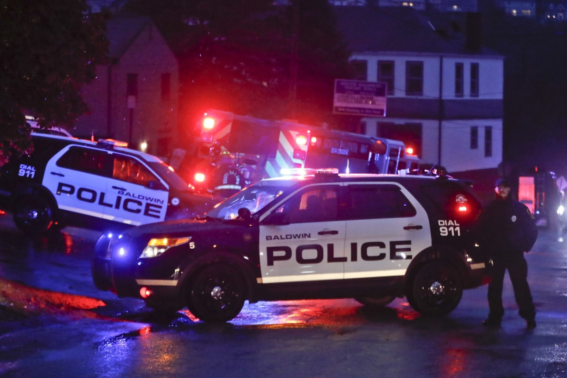 Emergency vehicles block off the area around the McAnulty Acres apartment complex as authorities continue their investigation of a shooting in a Pittsburgh synagogue where multiple people were killed on Saturday, Oct. 27, 2018 in Baldwin, Pa., a suburb south of Pittsburgh. (AP Photo/Keith Srakocic)