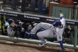 Los Angeles Dodgers' David Freese can't catch a foul ball hit by Boston Red Sox's J.D. Martinez during the second inning of Game 2 of the World Series baseball game Wednesday, Oct. 24, 2018, in Boston. (AP Photo/Charles Krupa)