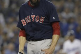 Boston Red Sox pitcher Rick Porcello celebrates the end of the seventh inning in Game 5 of the World Series baseball game against the Los Angeles Dodgers on Sunday, Oct. 28, 2018, in Los Angeles. (AP Photo/David J. Phillip)