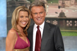 """Co-host Vanna White and host Pat Sajak make an appearance at Radio City Music Hall for a taping of celebrity week on """"Wheel of Fortune"""" hosted by People Magazine. The taped shows will air the week of November 12 to celebrate the shows 25th anniversary in New York, Saturday, Sept. 29, 2007. (AP Photo/Peter Kramer)"""