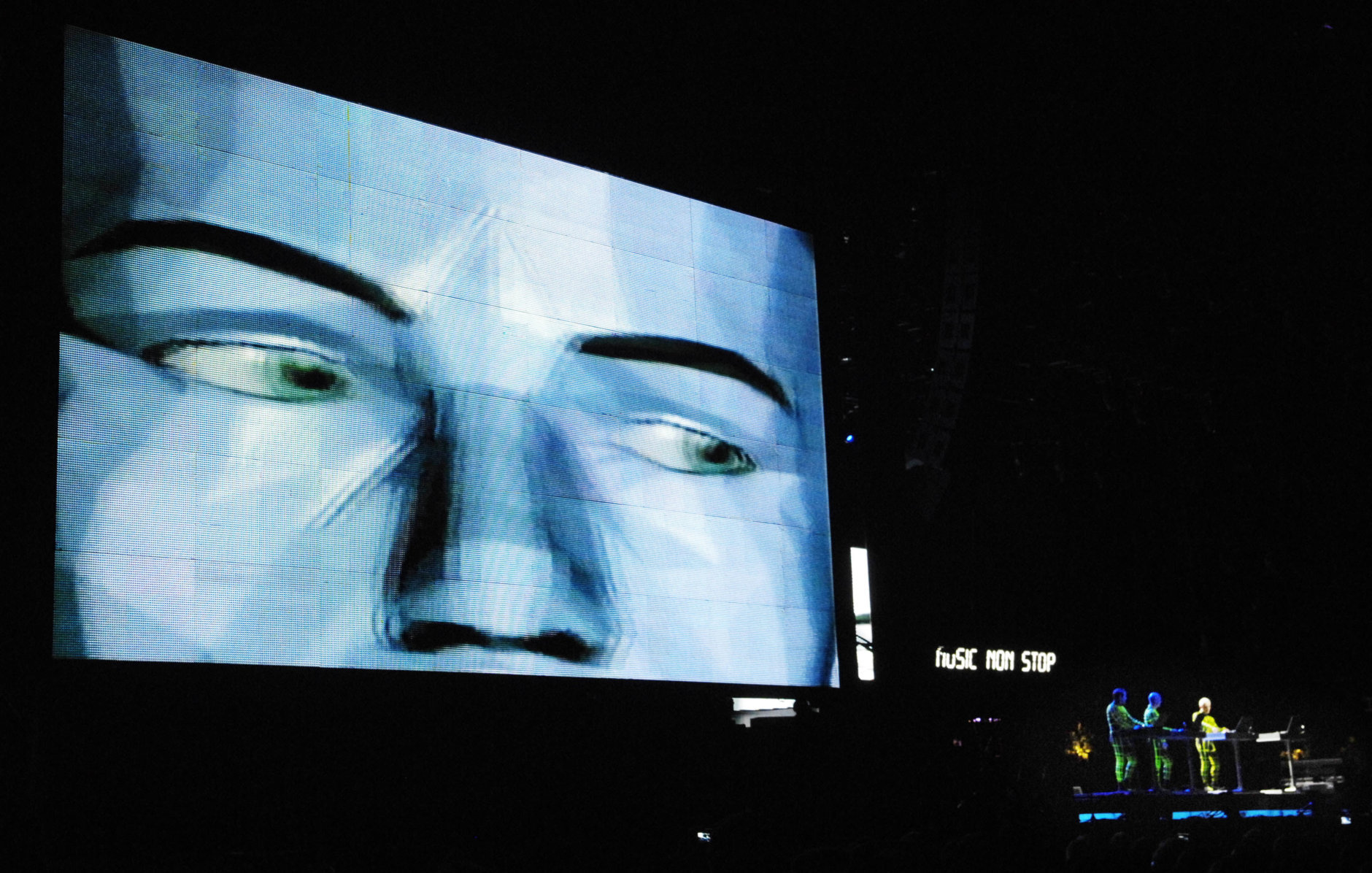 A video image looms over the band Kraftwerk, right, as they perform during the second day of the Coachella Valley Music and Arts Festival in Indio, Calif., Saturday, April 26, 2008. (AP Photo/Chris Pizzello)