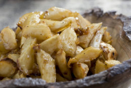 This Feb. 2, 2011 photo shows maple-garlic roasted parsnips  in Concord, N.H. Maple syrup creates a deliciously sweet glaze in this recipe. If parsnips aren't your thing, feel free to substitute carrots, beets or other root vegetables.    (AP Photo/Larry Crowe)