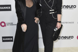 Sharon Osbourne, left, and Kelly Osbourne arrive at Elton John's 70th Birthday and 50-Year Songwriting Partnership with Bernie Taupin on Saturday, Mar. 25, 2017 in Los Angeles. (Photo by Jordan Strauss/Invision/AP)