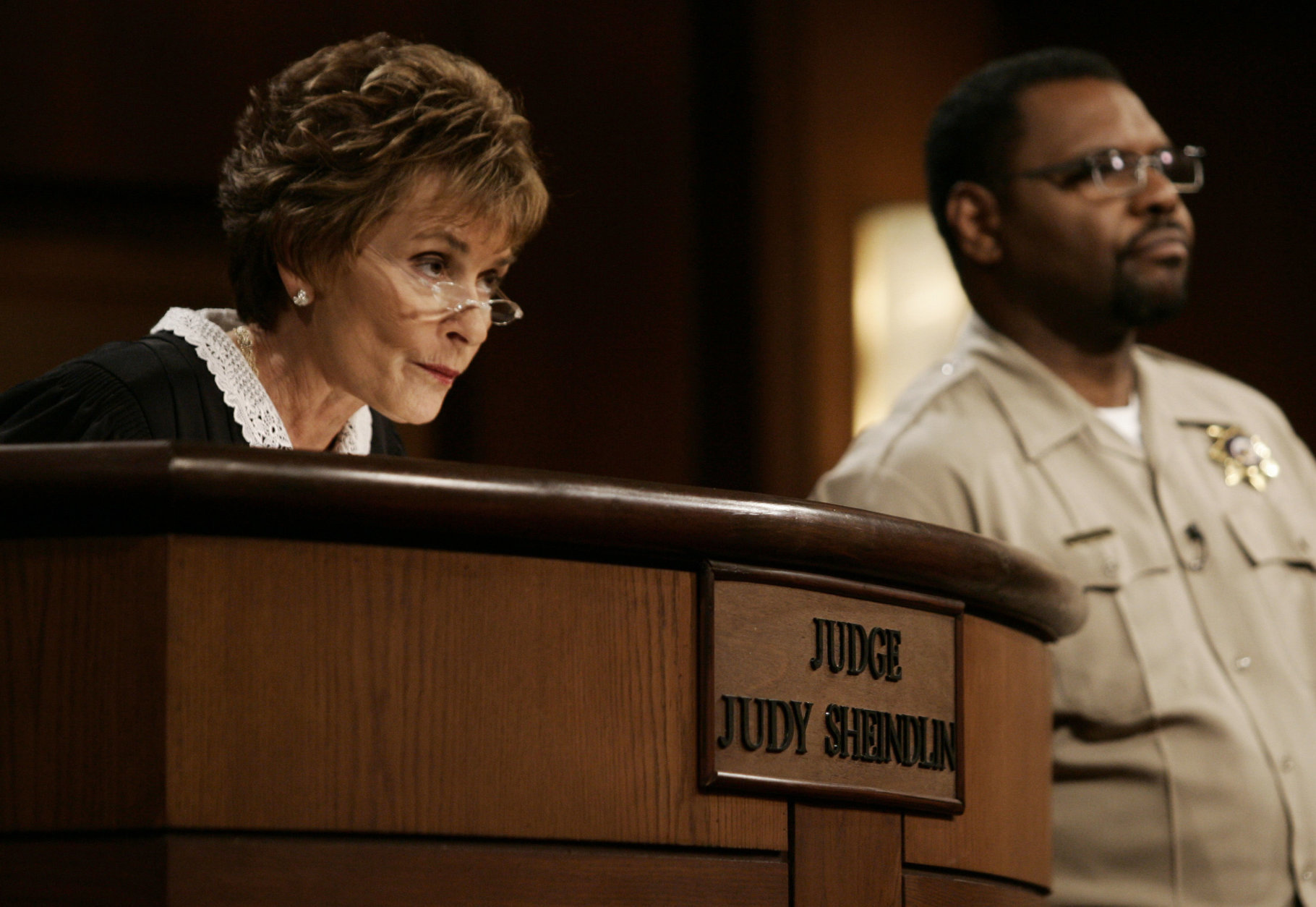 """FILE - In this Feb. 2, 2006, file photo, Judge Judy Sheindlin presides over a case as her bailiff Petri Hawkins Byrd listens on the set of her syndicated show """"Judge Judy"""" at the Tribune Studios in Los Angeles. Sheindlin, better known as Judge Judy, is funding a space for public debate at the University of Southern California. The forum, which was to be unveiled Tuesday night, Sept. 12, 2017, will host the USC Annenberg Debate Series. (AP Photo/Damian Dovarganes, File)"""