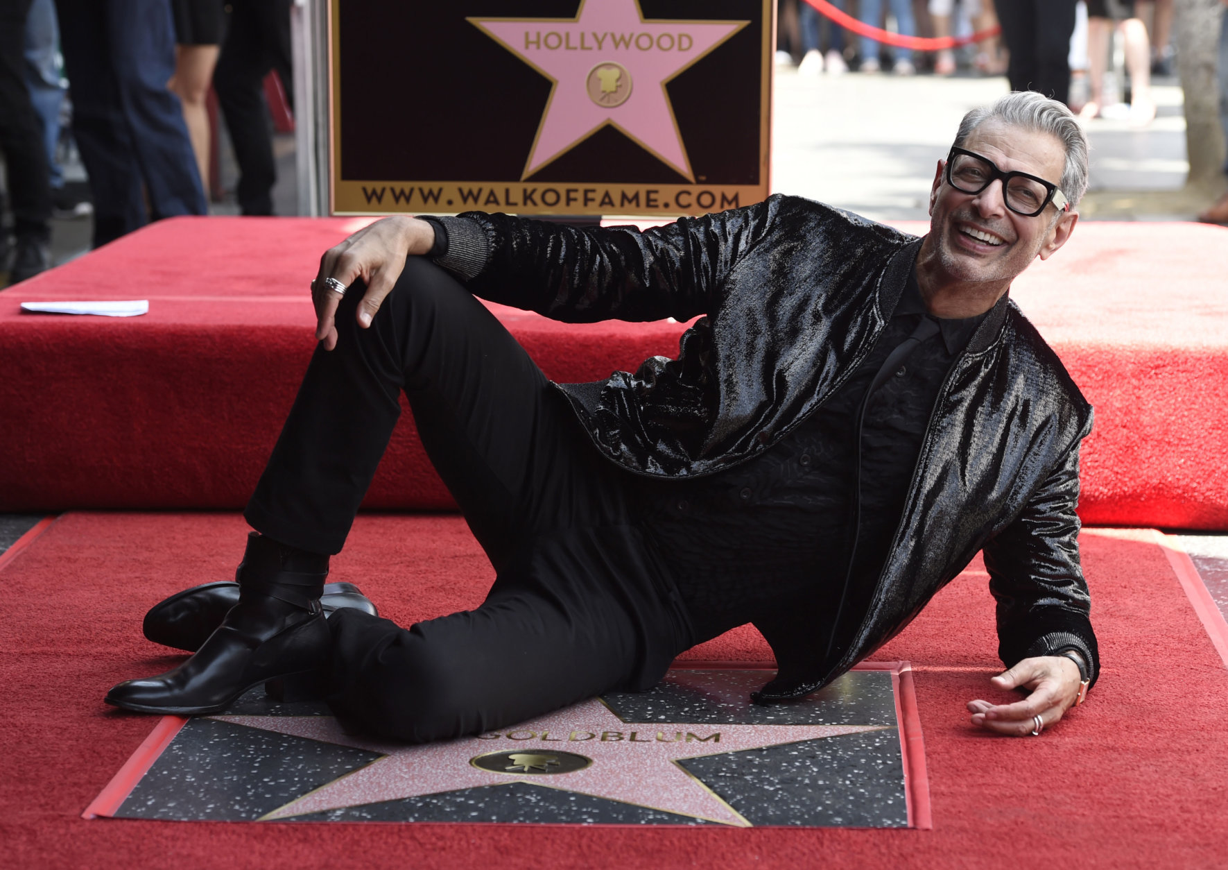 """Actor Jeff Goldblum, best known for his roles in """"The Fly,"""" """"Independence Day"""" and """"Jurassic Park, poses atop his star on the Hollywood Walk of Fame following a ceremony in his honor on Thursday, June 14, 2018, in Los Angeles. (Photo by Chris Pizzello/Invision/AP)"""
