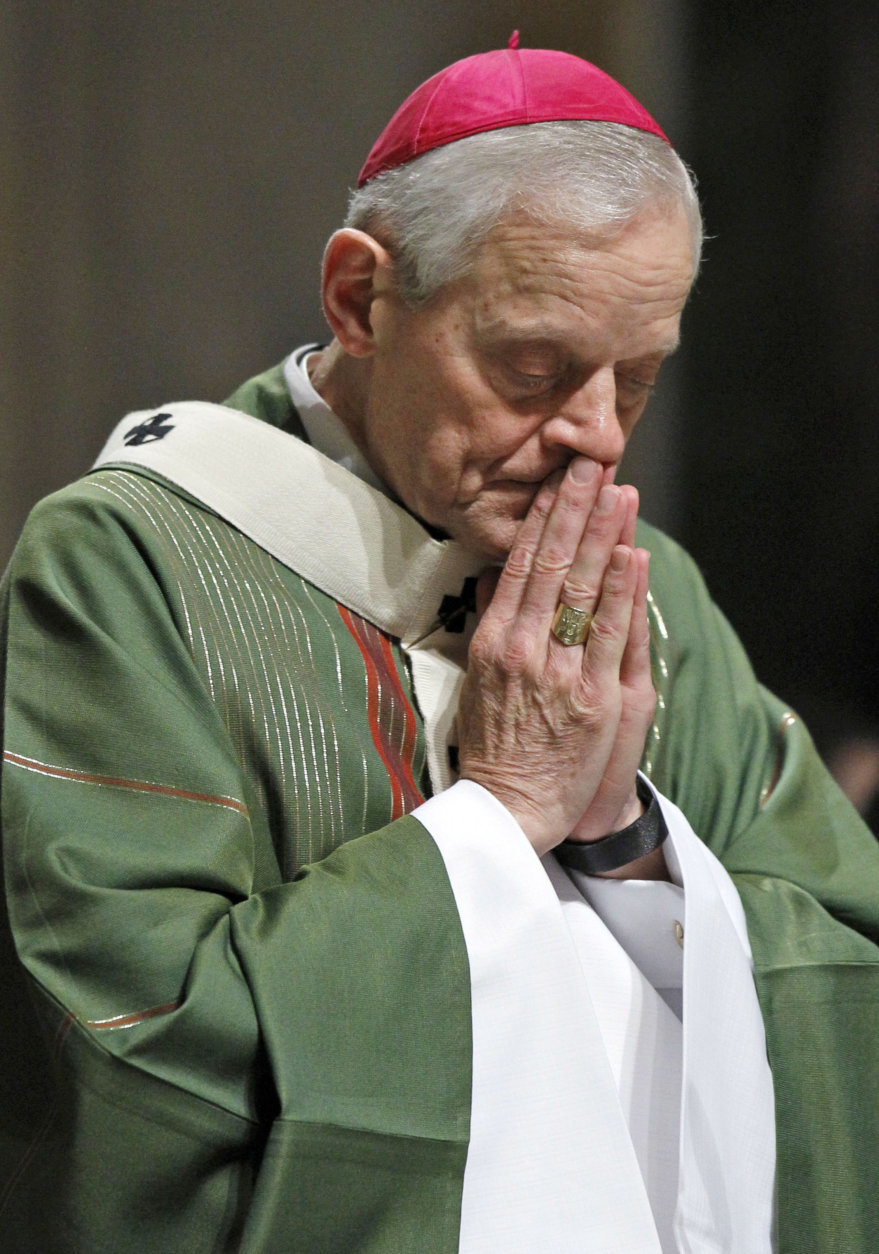 In this Wednesday, Oct. 20, 2010 file photo, Archbishop Donald Wuerl prays as he celebrates Mass at the Cathedral of Saint Matthew the Apostle in Washington. On Tuesday, Aug. 14, 2018, a Pennsylvania grand jury accused Cardinal Wuerl of helping to protect abusive priests when he was Pittsburgh's bishop. (AP Photo/Alex Brandon)