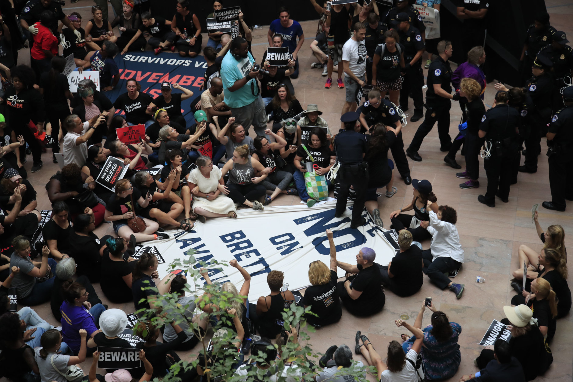 Protesters against Supreme Court nominee Brett Kavanaugh gather at Hart Senate Office Building atrium on Capitol Hill in Washington, Thursday, Oct. 4, 2018. (AP Photo/Manuel Balce Ceneta)