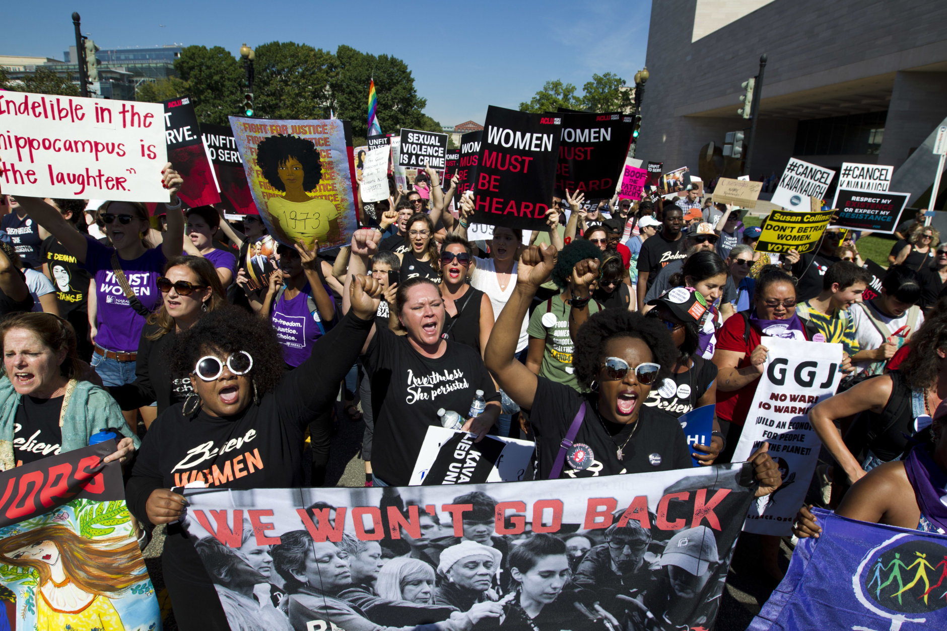 Demonstrators protest against Supreme Court nominee Brett Kavanaugh, as they march to the U.S. Supreme Court, on Thursday, Oct. 4, 2018, in Washington. (AP Photo/Jose Luis Magana)