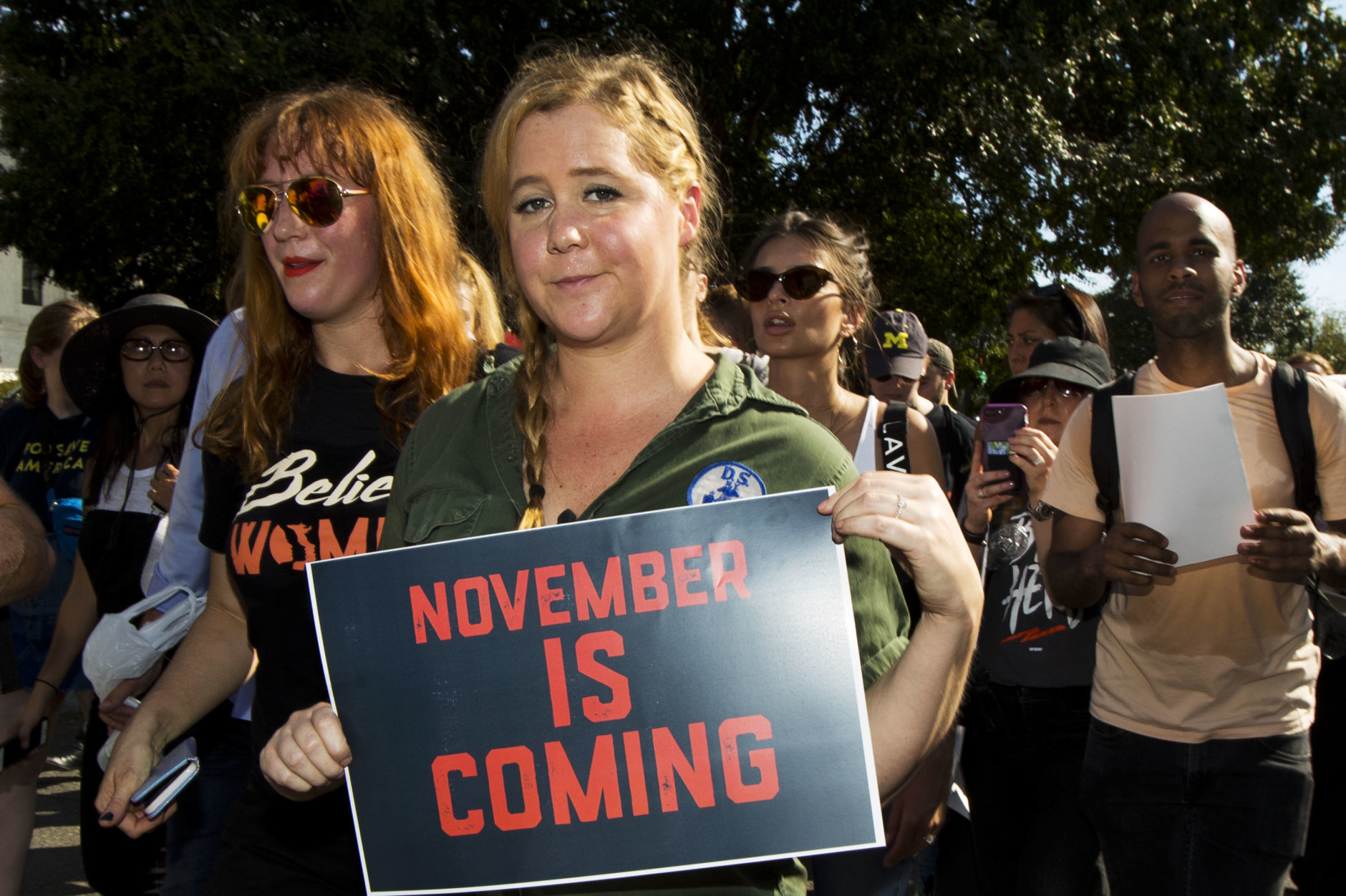Actress and comedian Amy Schumer joins a march against Supreme Court nominee Brett Kavanaugh from the Supreme Court to the Hart Senate Office Building in Washington, Thursday, Oct. 4, 2018. (AP Photo/Manuel Balce Ceneta)