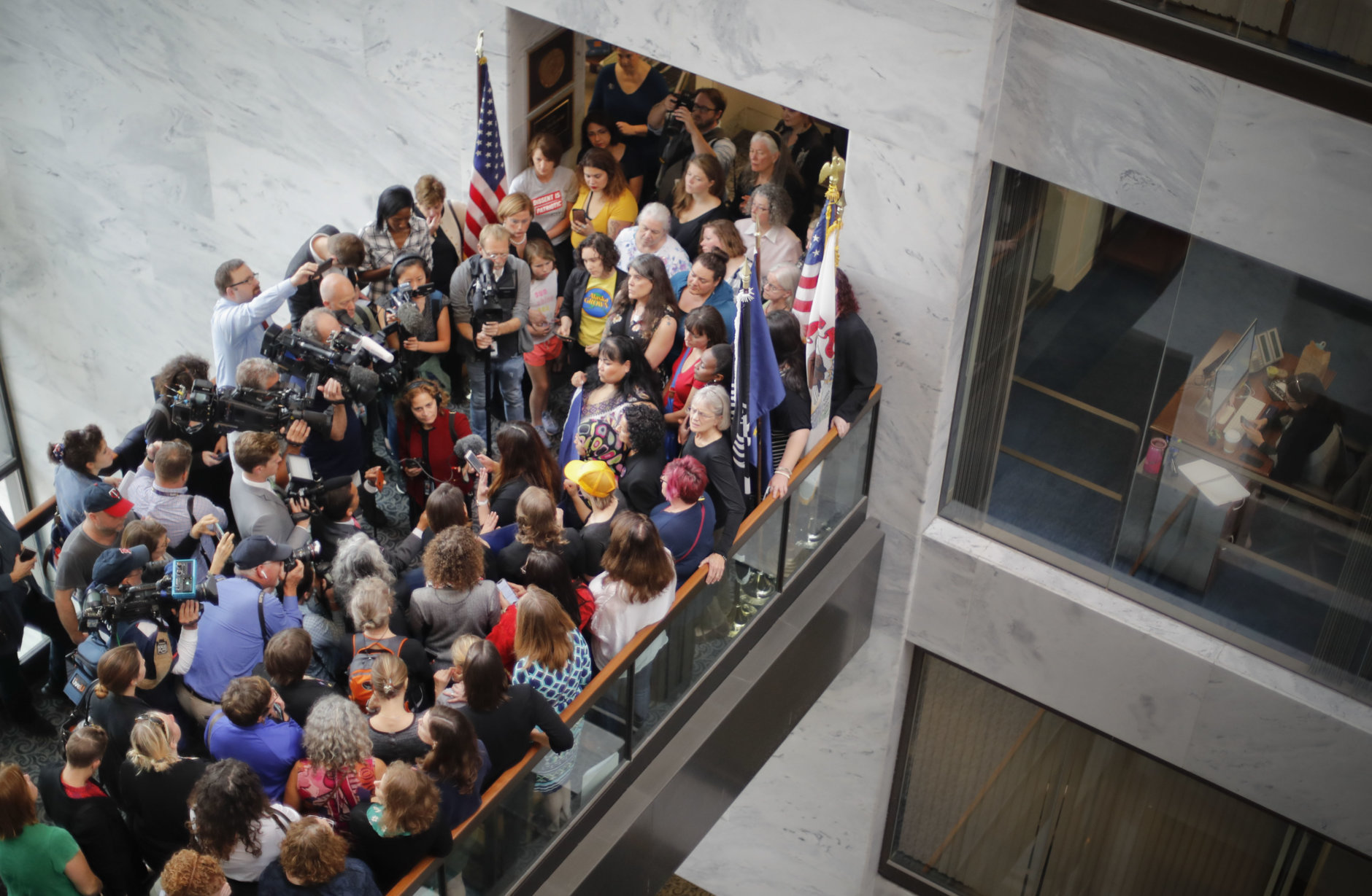Demonstrators gather outside the Senate office of Sen. Lisa Murkowski, R-Alaska, on Capitol Hill in Washington, Friday, Oct. 4, 2018. Murkowski was the lone Republican to vote against advancing Kavanaugh's nomination on Friday. (AP Photo/Pablo Martinez Monsivais)