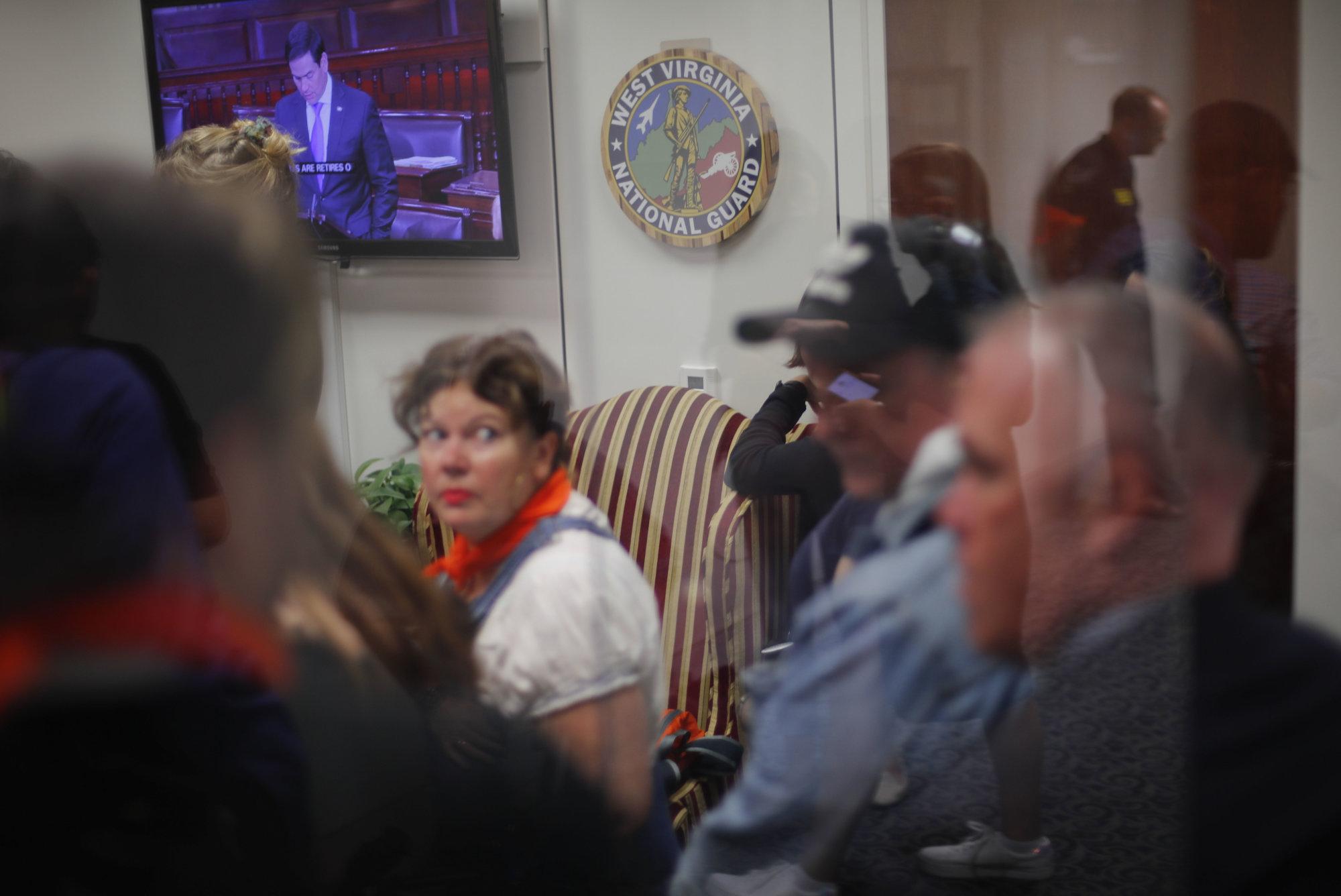 Demonstrators fill up the lobby entrance of Sen. Joe Manchin's, D-W.Va., Senate Office on Capitol Hill in Washington, Friday, Oct. 4, 2018. (AP Photo/Pablo Martinez Monsivais)