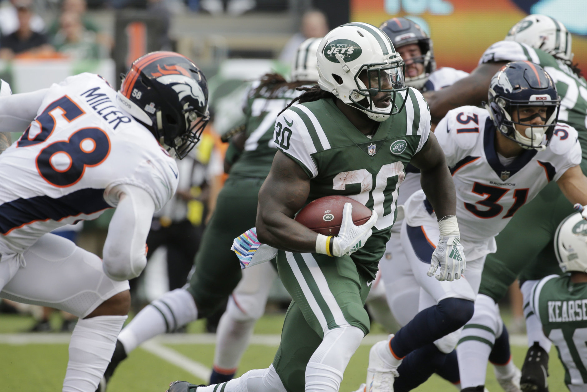 New York Jets' Isaiah Crowell (20) rushes past Denver Broncos' Von Miller (58) during the first half of an NFL football game Sunday, Oct. 7, 2018, in East Rutherford, N.J. (AP Photo/Seth Wenig)