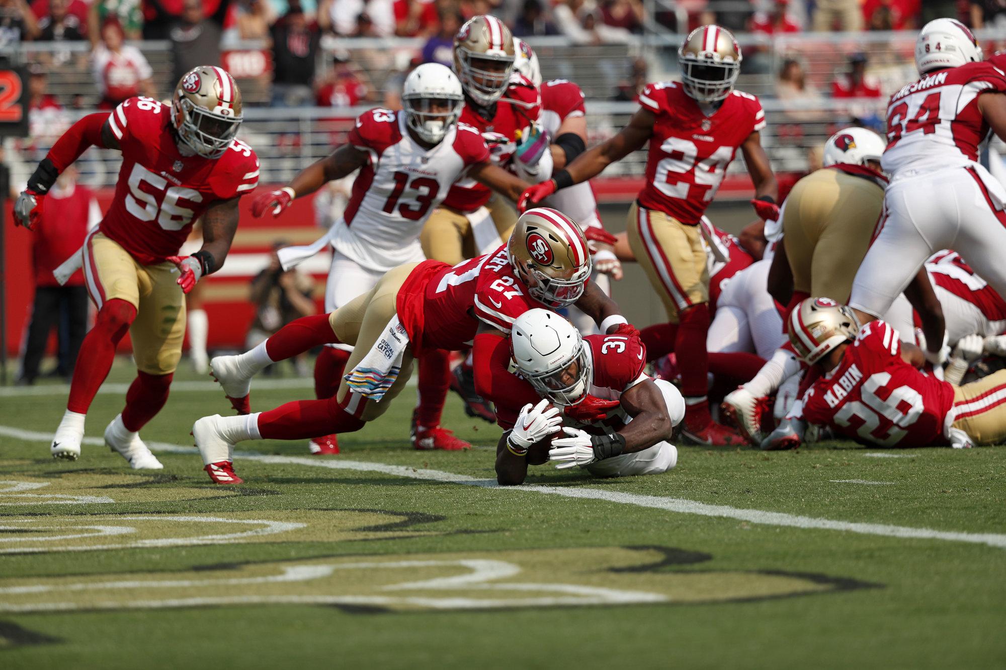Arizona Cardinals running back David Johnson (31) scores a touchdown against San Francisco 49ers defensive back Adrian Colbert (27) during the first half of an NFL football game in Santa Clara, Calif., Sunday, Oct. 7, 2018. (AP Photo/Tony Avelar)