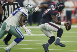 Houston Texans quarterback Deshaun Watson (4) is pressured by Dallas Cowboys defensive tackle Daniel Ross (93) during the first half of an NFL football game, Sunday, Oct. 7, 2018, in Houston. (AP Photo/David J. Phillip)