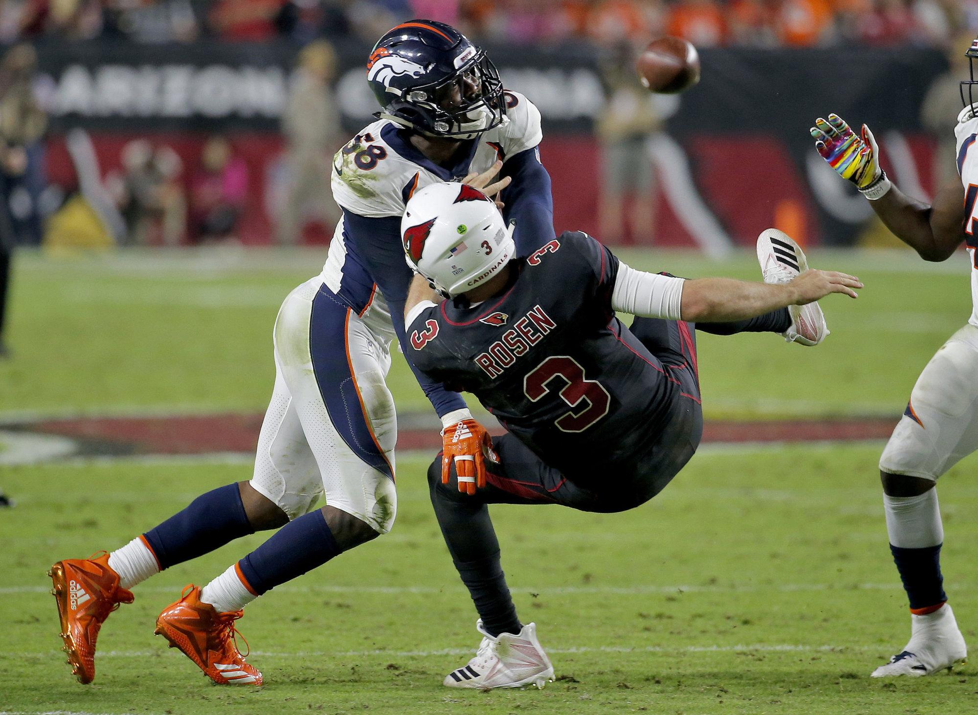 Denver Broncos linebacker Von Miller (58) hits Arizona Cardinals quarterback Josh Rosen (3) as he throws during the second half of an NFL football game, Thursday, Oct. 18, 2018, in Glendale, Ariz. (AP Photo/Rick Scuteri)
