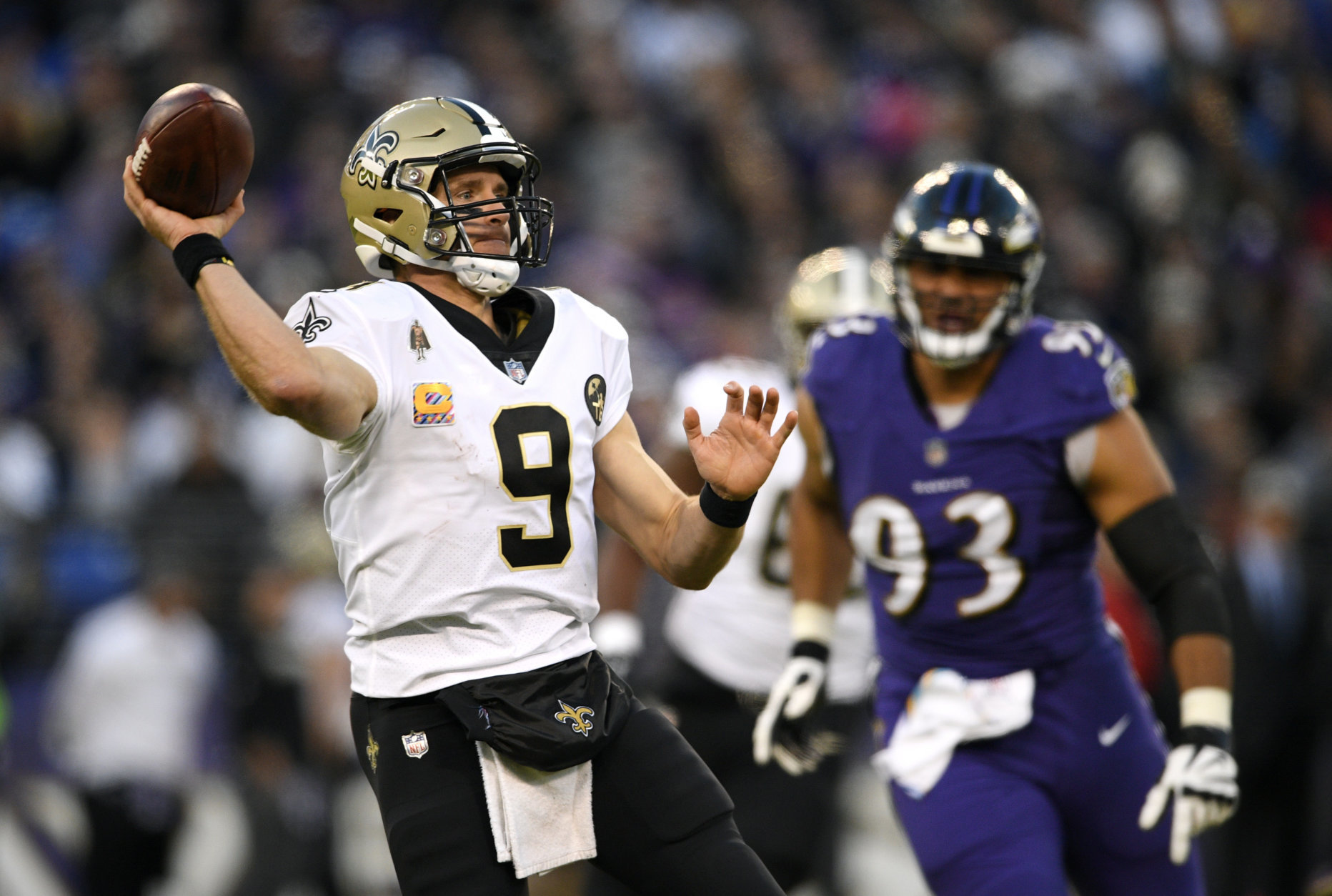 New Orleans Saints quarterback Drew Brees (9) prepares to throw to a receiver in the second half of an NFL football game against the Baltimore Ravens, Sunday, Oct. 21, 2018, in Baltimore. (AP Photo/Nick Wass)