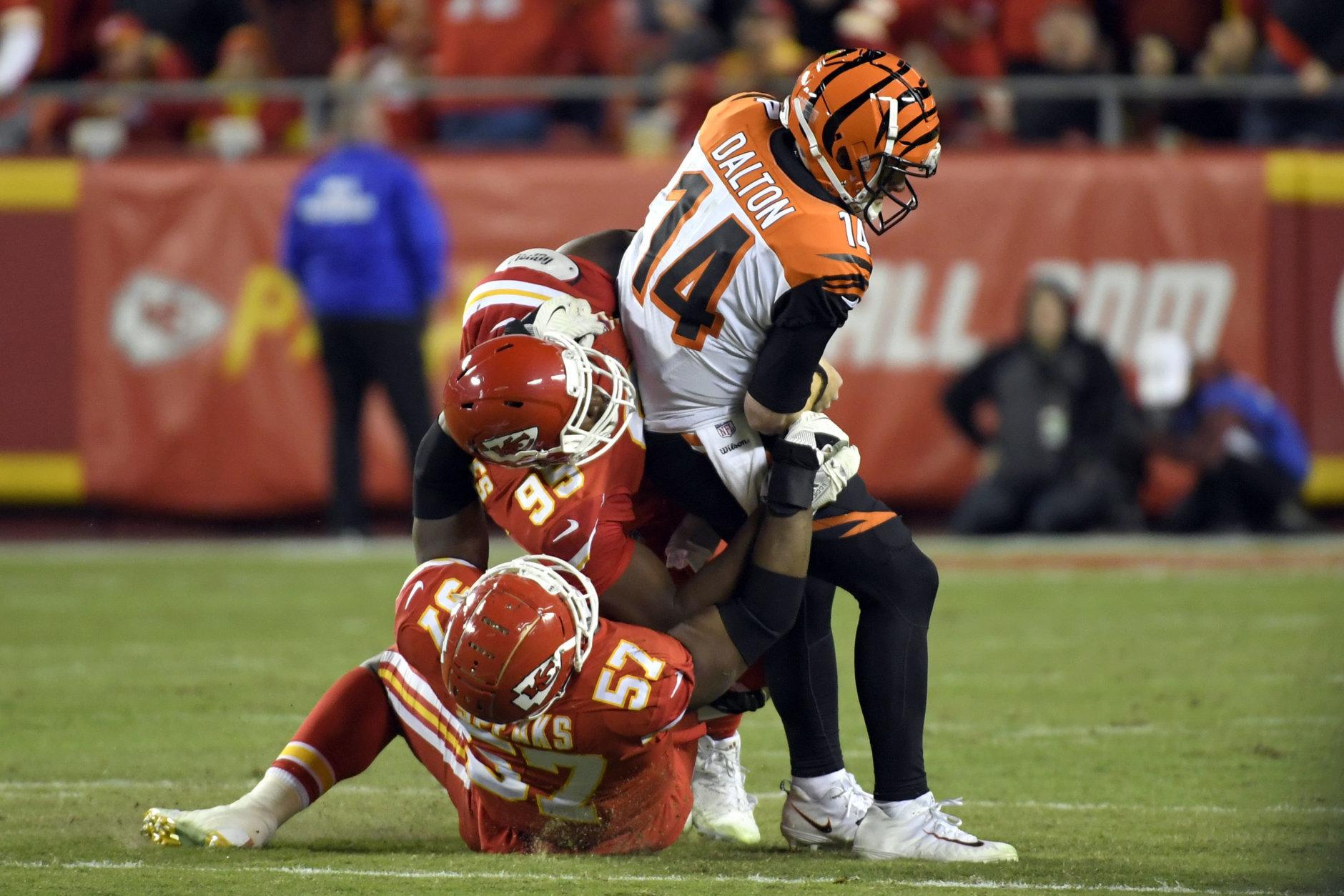 Kansas City Chiefs linebacker Breeland Speaks (57) and defensive lineman Chris Jones (95) sack Cincinnati Bengals quarterback Andy Dalton (14) during the second half of an NFL football game in Kansas City, Mo., Sunday, Oct. 21, 2018. The Chiefs won, 45-10. (AP Photo/Reed Hoffmann)