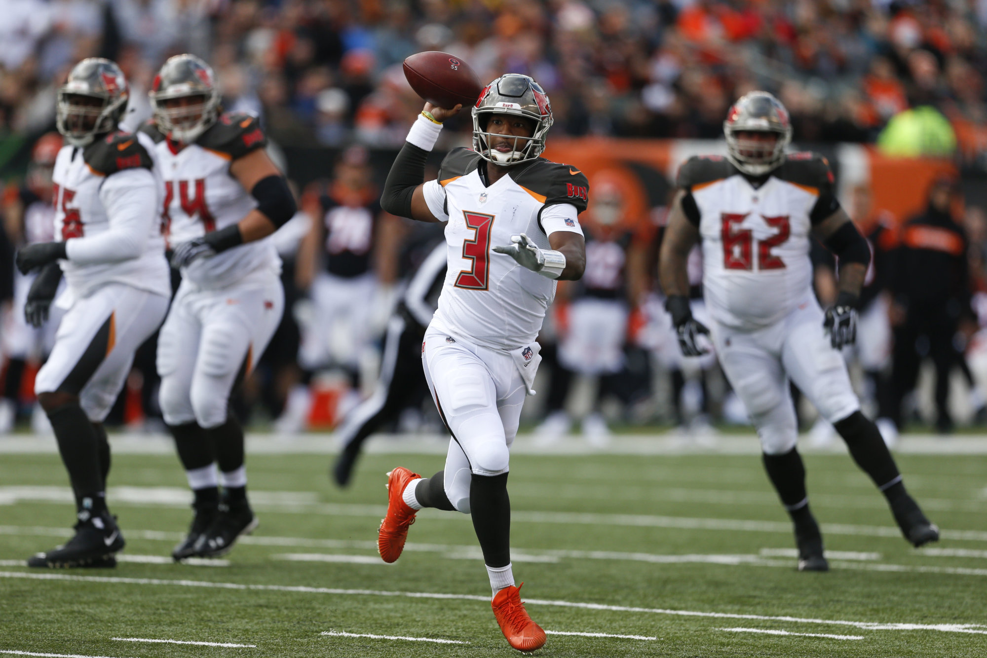 Tampa Bay Buccaneers quarterback Jameis Winston (3) scramble against the Cincinnati Bengals during the first half of an NFL football game in Cincinnati, Sunday, Oct. 28, 2018. (AP Photo/Gary Landers)