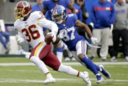 Washington Redskins free safety D.J. Swearinger (36) brings the ball back up the field after intercepting a pass by New York Giants quarterback Eli Manning during the third quarter of an NFL football game, Sunday, Oct. 28, 2018, in East Rutherford, N.J. (AP Photo/Seth Wenig)