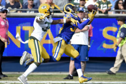 Los Angeles Rams running back Todd Gurley, right, makes a catch as Green Bay Packers defensive back Jermaine Whitehead defends during the first half of an NFL football game, Sunday, Oct. 28, 2018, in Los Angeles. (AP Photo/Denis Poroy)