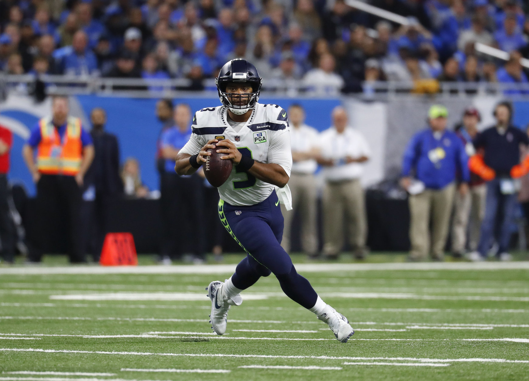 Seattle Seahawks quarterback Russell Wilson rolls out to pass against the Detroit Lions during an NFL football game in Detroit, Sunday, Oct. 28, 2018. (AP Photo/Paul Sancya)