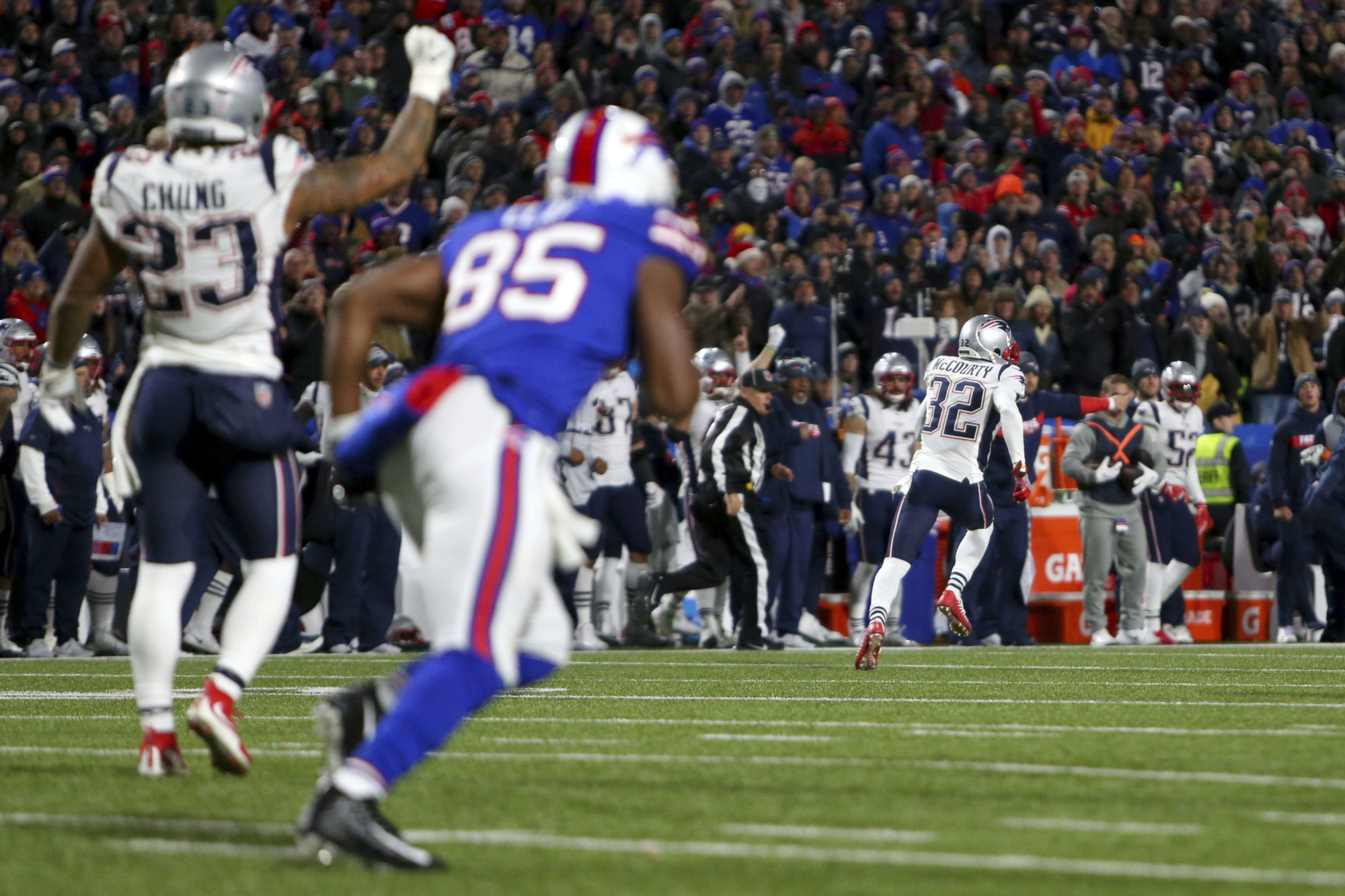 New England Patriots free safety Devin McCourty (32) returns an interception for a touchdown on a pass from Buffalo Bills quarterback Derek Anderson, not pictured, during the second half of an NFL football game, Monday, Oct. 29, 2018, in Orchard Park, N.Y. (AP Photo/Jeffrey T. Barnes)