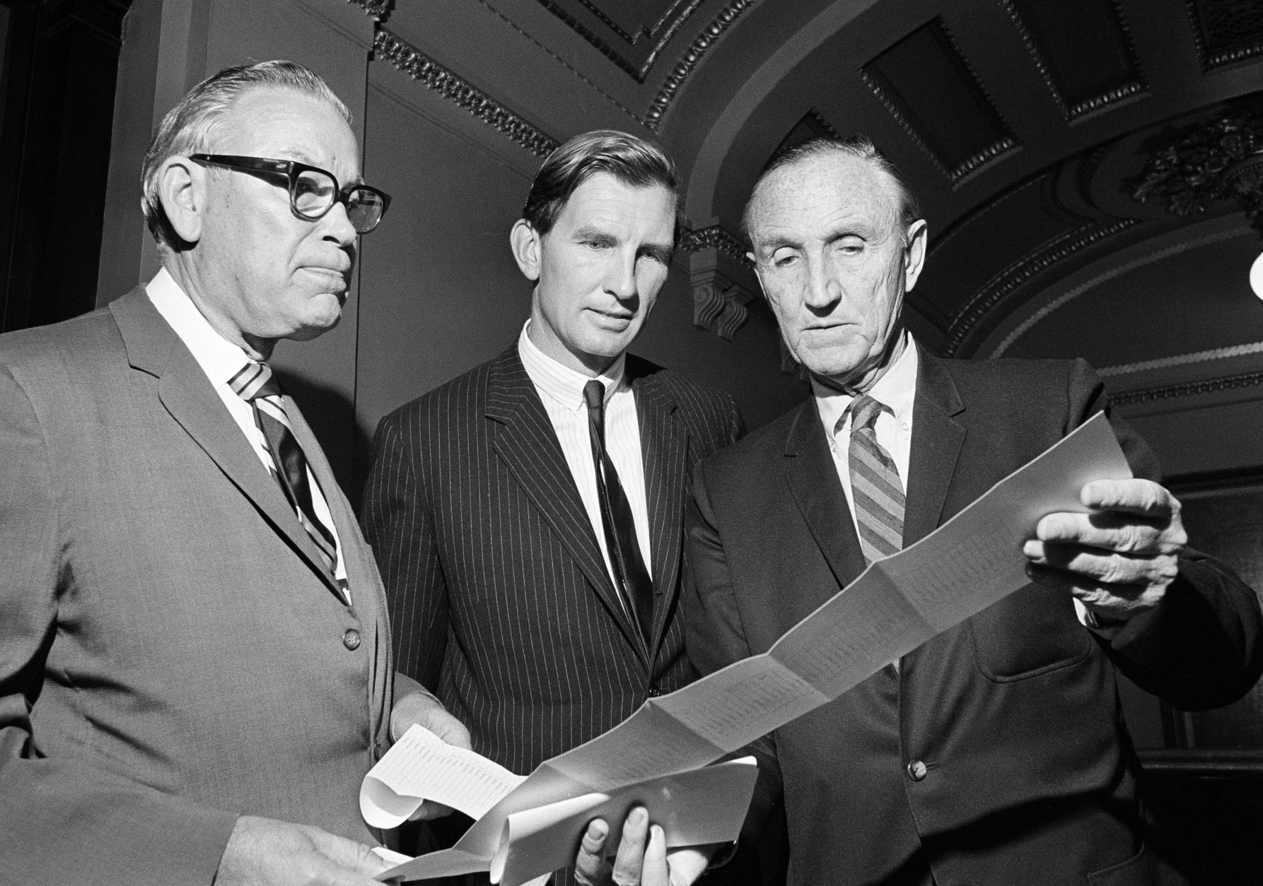 The Senate passed the controversial crime control bill for D.C. over protests by opponents that parts of it trample on Constitutional rights, July 23, 1970, in Washington. From left: Sen. Roman L. Hruska (R-Neb.), Sen. Joseph D. Tydings (D-Md.) and Sen. Mike Mansfield (D-Mont.), checking the voting results. (AP Photo)