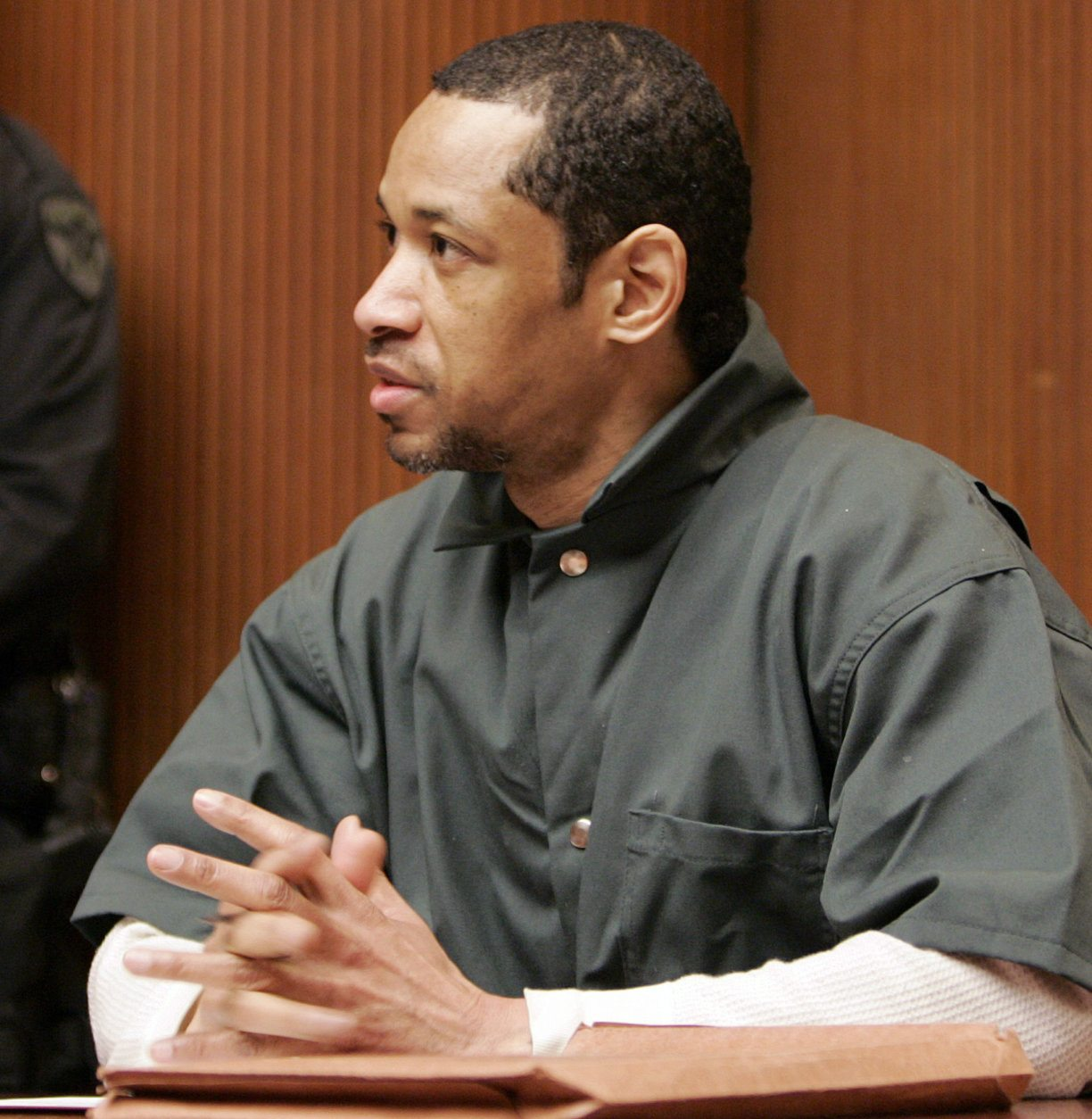 """FILE - In this Friday, April 28, 2006 file photo, convicted sniper John Allen Muhammad addresses Judge James L. Ryan during a media preview before the start of his trial in Rockville, Md. Convicted D.C. sniper Lee Boyd Malvo, aka John Lee Malvo, said in a newspaper interview published Sunday, Sept. 30, 2012, that the devastated reaction of a victim's husband made him feel like """"the worst piece of scum."""" Malvo expresses remorse in the interview with The Washington Post and urged the families of victims to try and forget about him and his partner, Muhammad, so they can move on. Tuesday, Oct. 2, marks the 10th anniversary of the beginning of the deadly spree in the Washington area carried by Malvo and Muhammad. The pair has been linked to 27 shootings across the country, including 10 fatal attacks in the Washington area. (AP Photo/Chris Gardner, Pool, File)"""