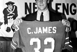 Runningback Craig James holds up his new jersey during a press conference, on Friday, April 20, 1984 at Sullivan Stadium in Foxboro, Mass., where it was announced that he has signed with the New England Patriots football team. James, formerly of the USFL's Washington Federals and Southern Methodist University, was a 7th-round draft pick of the Pastriots in the 1983 NFL Draft. (AP Photo/Ted Qartland)