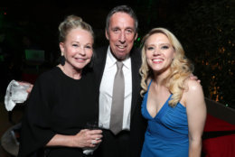 """Genevieve Robert, Ivan Reitman, and Kate McKinnon are seen at the Los Angeles Premiere of Columbia Pictures' """"Ghostbusters"""" at TCL Chinese Theatre on Saturday, July 9, 2016, in Los Angeles. (Photo by Eric Charbonneau/Invision for Sony/AP Images)"""