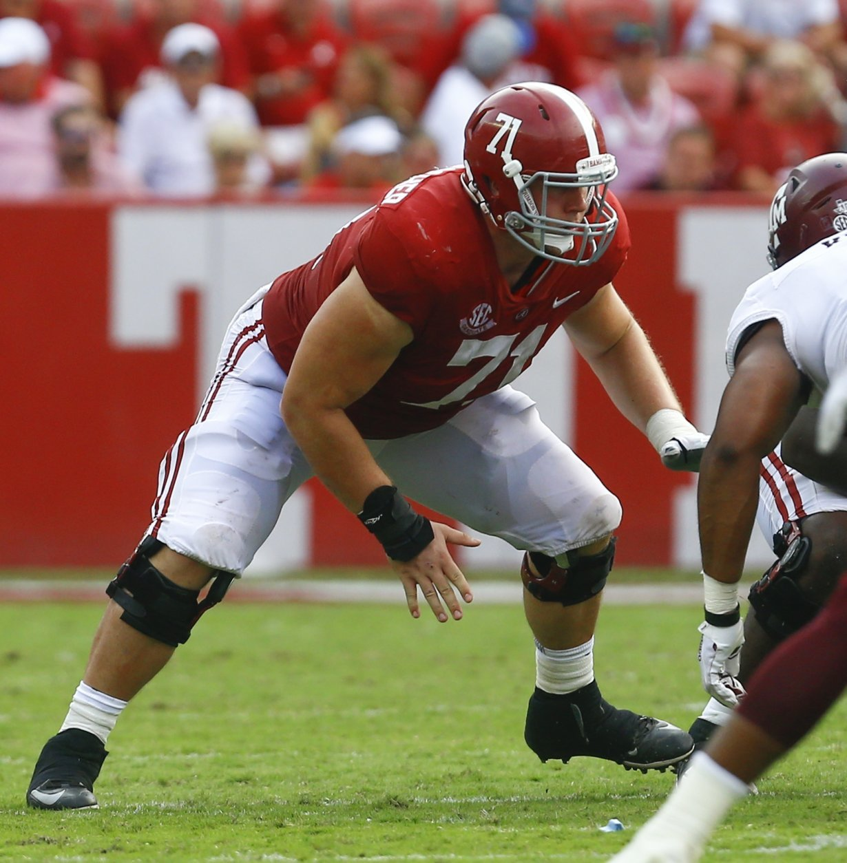 FILE - In this Sept. 22, 2018, file photo, Alabama offensive lineman Ross Pierschbacher (71) blocks out against Texas A&M during the second half of an NCAA college football game, in Tuscaloosa, Ala. Pierschbacher was named to The Associated Press Midseason All-America team, Tuesday, Oct. 16, 2018.(AP Photo/Butch Dill, File)