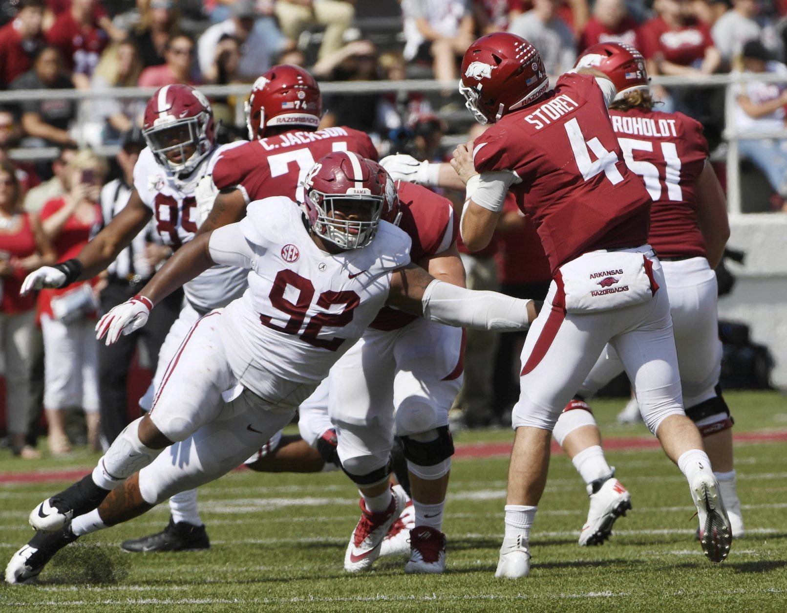 "FILE - In this Oct. 6, 2018, file photo, Alabama defensive lineman Quinnen Williams puts the pressure on Arkansas quarterback Ty Storey in the second half of an NCAA college football game, in Fayetteville, Ark. The guys who have to block Quinnen Williams in practice aren't the least bit surprised by his success on Alabama's defensive line. Williams has emerged as a dominant force for the top-ranked Crimson Tide at nose guard, doing in games what he has often done in practice. ""I think we're honestly a little relieved as an (offensive) line that we're like, 'OK, no one else can block him either,'"" Alabama left tackle Jonah Williams said. (AP Photo/Michael Woods, File)"
