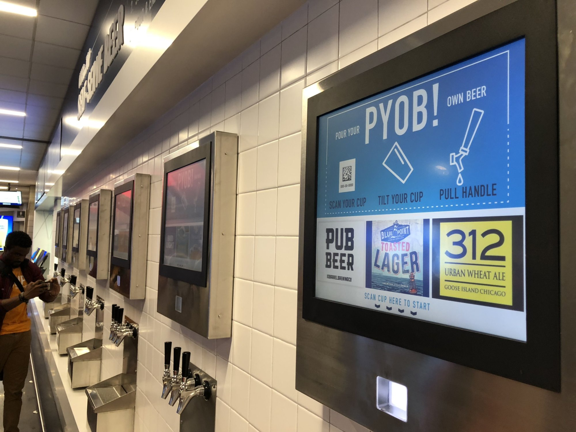The beer wall near section 417 offers 17 different varieties of self-serve beers. (WTOP/Kristi King)