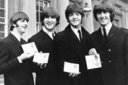 "FILE - In this Oct. 26, 1965 file photo The Beatles, from left: Ringo Starr, John Lennon, Paul McCartney and George Harrison smile as they display the Member of The Order of The British Empire medals presented to them by Queen Elizabeth II in a ceremony in Buckingham Palace in London, England. The Beatles' psychedelic masterwork ""Sgt. Pepper's Lonely Hearts Club Band"" has been named the most popular British album in history. (AP Photo, File)"