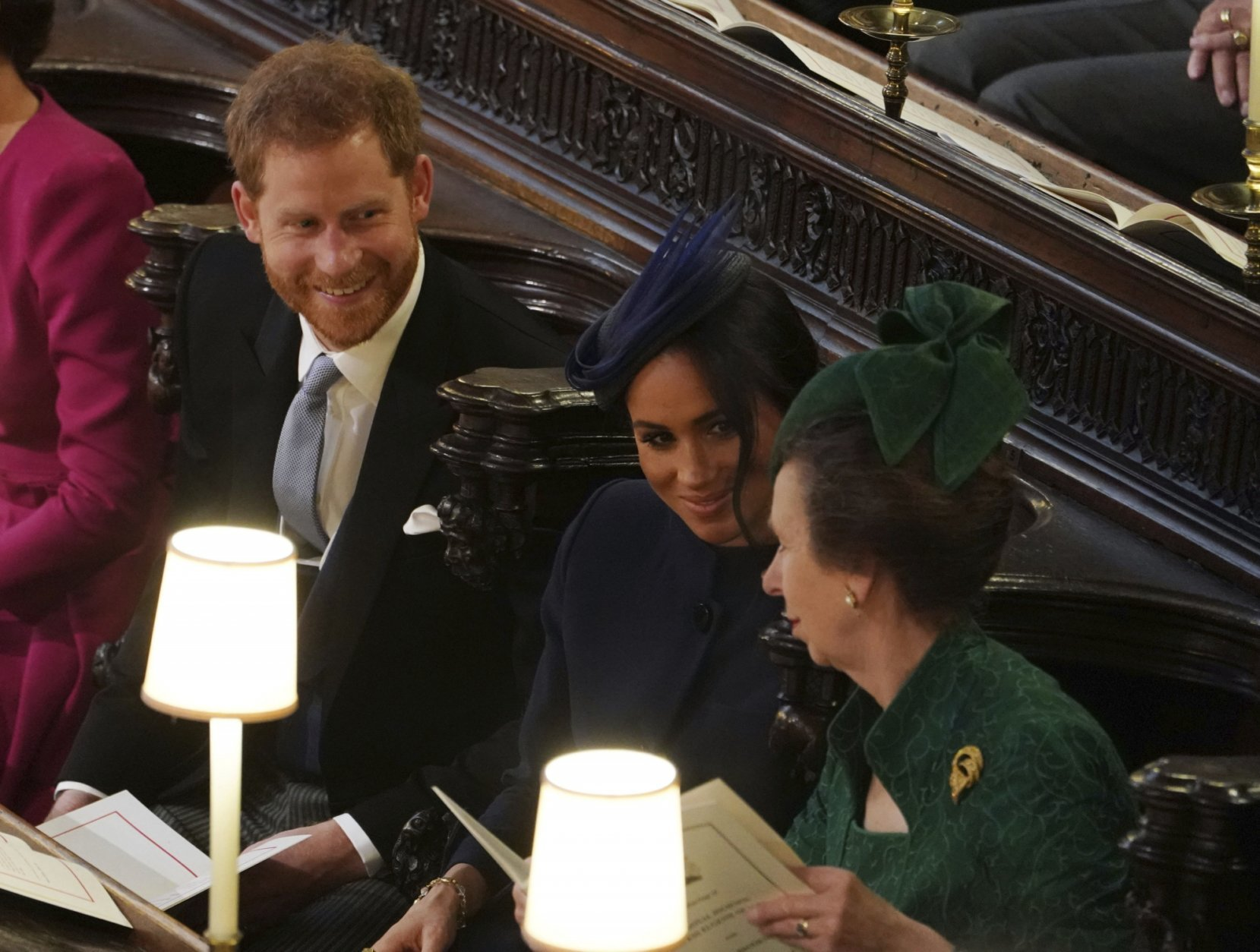 Britain's Prince Harry, Meghan, Duchess of Sussex and Britain's Princess Anne, from left, attend the wedding of Princess Eugenie of York and Jack Brooksbank in St George's Chapel, Windsor Castle, near London, England, Friday Oct. 12, 2018. (Owen Humphreys, Pool via AP)