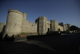 Windsor Castle stands under a blue sky ahead of the wedding of Britain's Princess Eugenie in Windsor, England, Wednesday, Oct. 10, 2018. The 28-year-old granddaughter of Queen Elizabeth II is due to marry liquor company executive Jack Brooksbank on Friday in St. George's Chapel at Windsor Castle. (AP Photo/Matt Dunham)