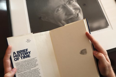 AP Exclusive: Stephen Hawking's wheelchair, thesis for sale