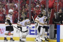 Boston Bruins goaltender Tuukka Rask (40), of Finland, leaves the ice as he is replaced Jaroslav Halak (41), of Slovakia, during the second period of the team's NHL hockey game against the Washington Capitals, Wednesday, Oct. 3, 2018, in Washington. At left is Bruins center Joakim Nordstrom (20). (AP Photo/Nick Wass)