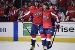 Washington Capitals left wing Alex Ovechkin (8), of Russia, celebrates his goal with T.J. Oshie (77) during the second period of the team's NHL hockey game against the Boston Bruins, Wednesday, Oct. 3, 2018, in Washington. (AP Photo/Nick Wass)