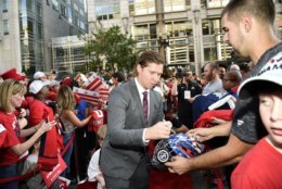Washington Capitals' Nicklas Backstrom, of Sweden, signs for fans as he walks the red carpet before their opening season NHL hockey game against the Boston Bruins, Wednesday, Oct. 3, 2018, in Washington. (AP Photo/Nick Wass)