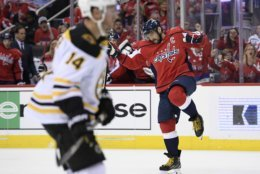 Washington Capitals left wing Alex Ovechkin, right, of Russia, celebrates his goal as Boston Bruins right wing Chris Wagner skates nearby during the second period of an NHL hockey game Wednesday, Oct. 3, 2018, in Washington. (AP Photo/Nick Wass)