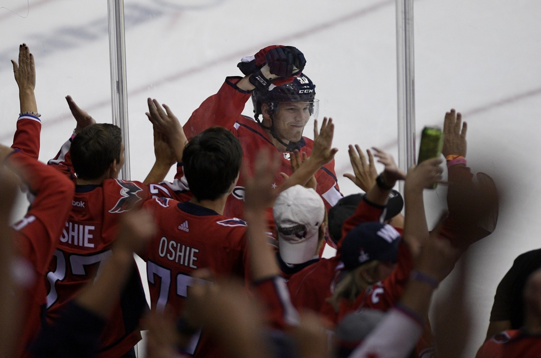 Washington Capitals center Lars Eller (20), of Denmark, celebrates his goal during the third period of the team's NHL hockey game against the Boston Bruins, Wednesday, Oct. 3, 2018, in Washington. The Capitals won 7-0. (AP Photo/Nick Wass)