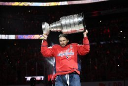 Washington Capitals left wing Alex Ovechkin, of Russia, carries the Stanley Cup during a banner-raising ceremony before the team's NHL hockey game against the Boston Bruins, Wednesday, Oct. 3, 2018, in Washington. (AP Photo/Nick Wass)