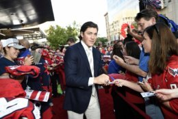 Washington Capitals' T.J. Oshie signs for fans as he walks the red carpet before their opening season NHL hockey game against the Boston Bruins, Wednesday, Oct. 3, 2018, in Washington. (AP Photo/Nick Wass)