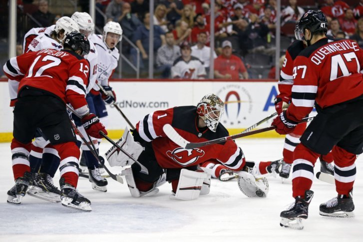 New Jersey Devils goaltender Keith Kinkaid (1) makes a save against the  Washington Capitals during the third period of an NHL hockey game Thursday 5c984b926c3